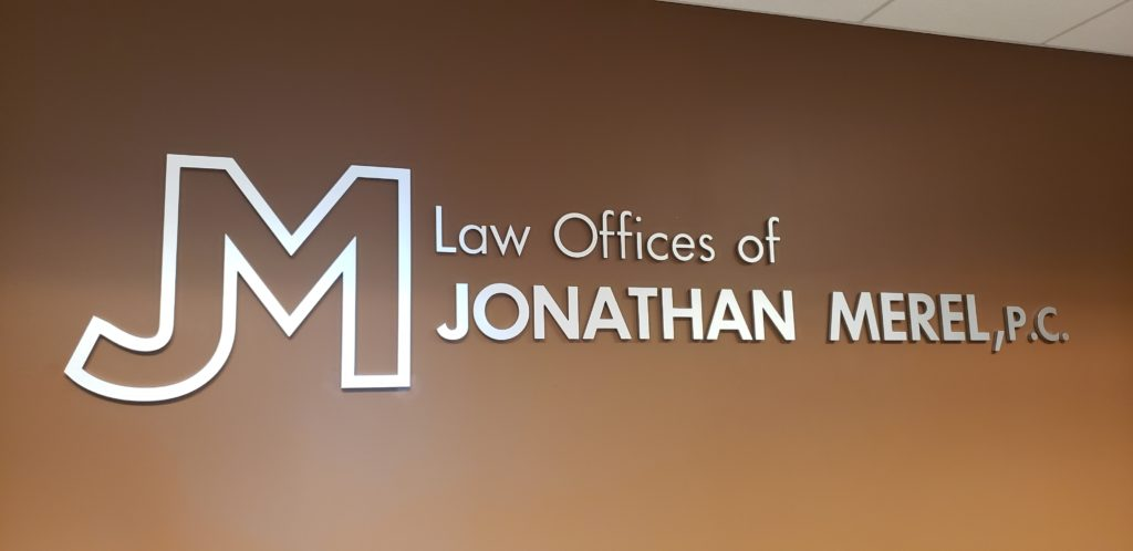 Law office sign on brown wall