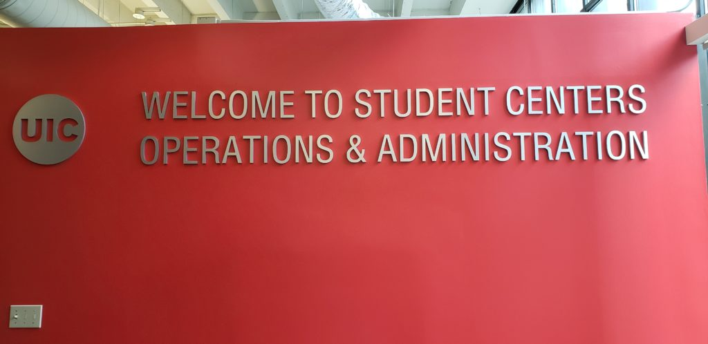 University sign on red wall