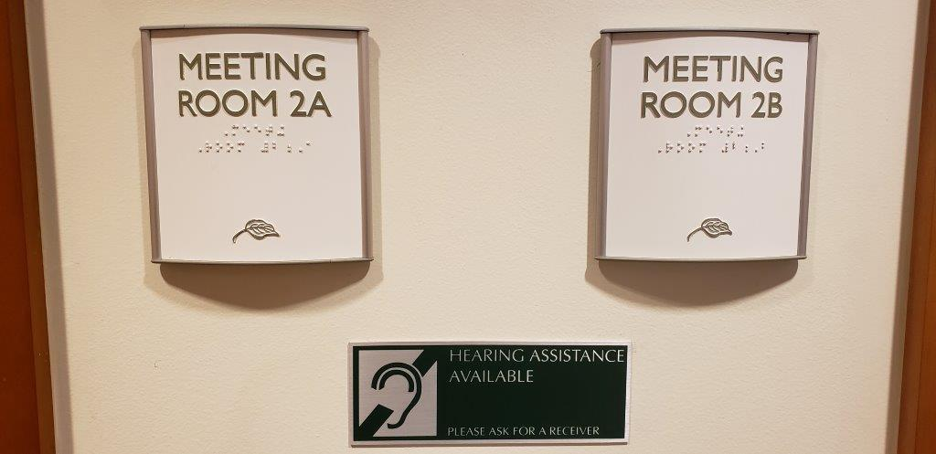 ADA compliant library meeting room signs.